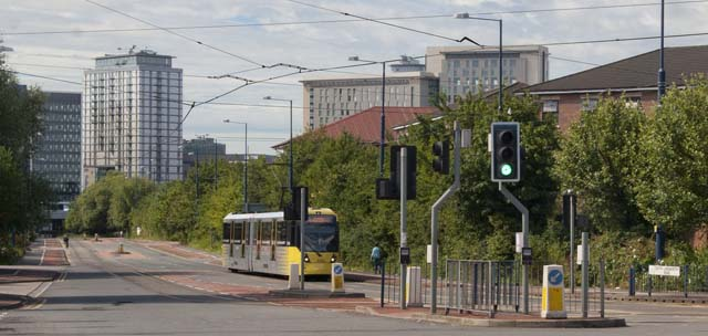 Metrolink tram passing Quays Reach, with MediaCityUK (Salford) in the background
